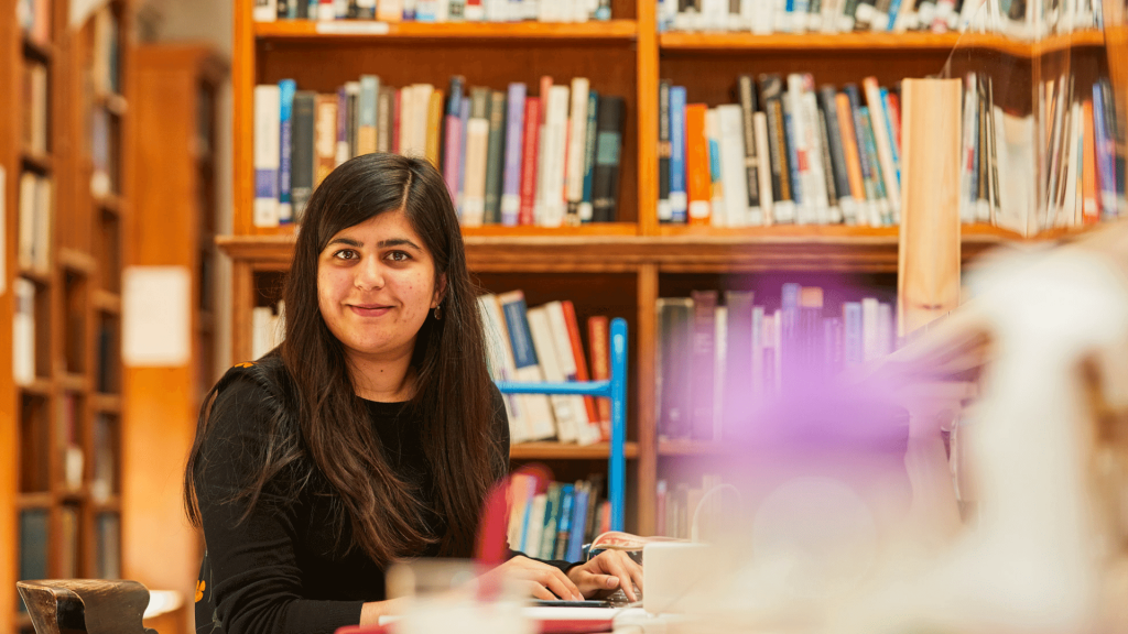 Student studying in the Exeter College Library
